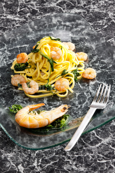 spaghetti with prawns and spinach Stock photo © phbcz