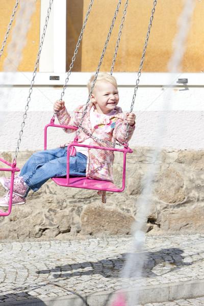 Meisje carrousel meisje kind jeans spelen Stockfoto © phbcz