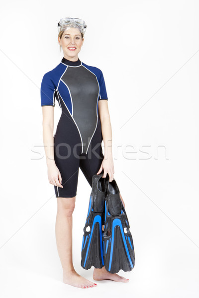 standing young woman wearing neoprene with flippers and diving g Stock photo © phbcz