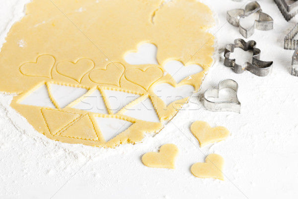 still life of dough with cookie cutters Stock photo © phbcz