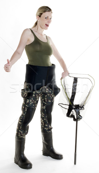 fisher woman with fishing net in studio Stock photo © phbcz