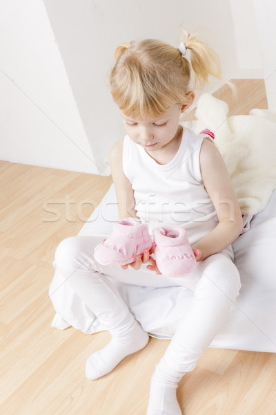 little girl with clothes and shoes for a baby Stock photo © phbcz