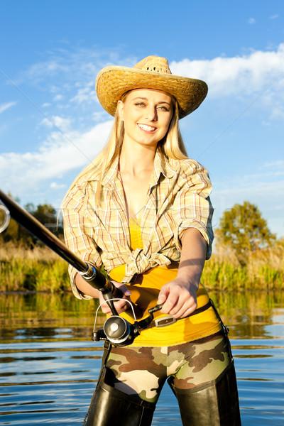 Femme pêche étang femmes portrait permanent Photo stock © phbcz