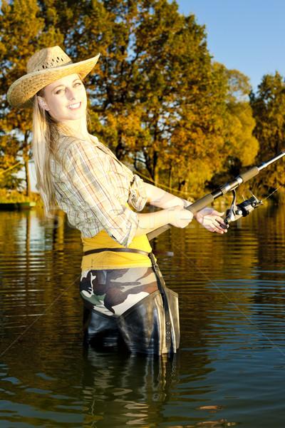 Mulher pescaria lagoa mulheres outono em pé Foto stock © phbcz