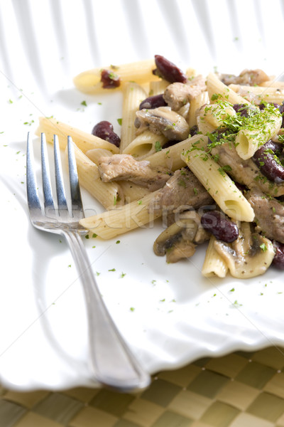 penne with pork pieces and champignons Stock photo © phbcz