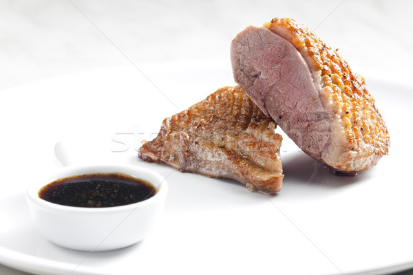 Frit canard sein sauce miel vin rouge Photo stock © phbcz
