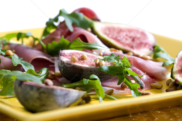 Spanish ham with figs and pine nuts Stock photo © phbcz