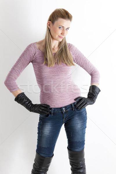 Stockfoto: Portret · permanente · vrouw · jeans · zwarte