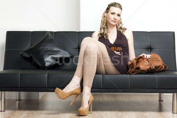 woman wearing pumps with a handbag sitting on sofa Stock photo © phbcz
