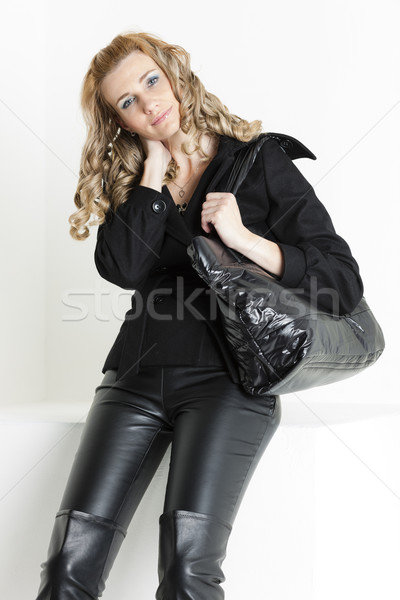 portrait of sitting woman in black clothes with a handbag Stock photo © phbcz