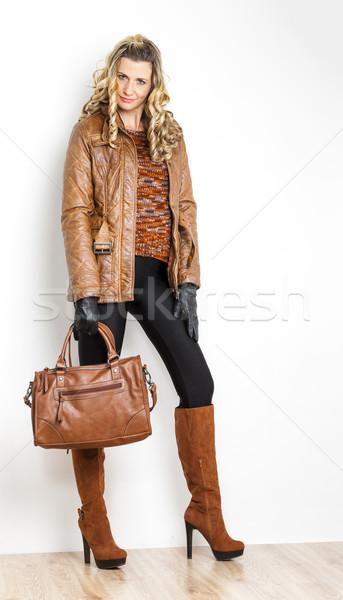 Постоянный женщину модный коричневый сапогах Сток-фото © phbcz