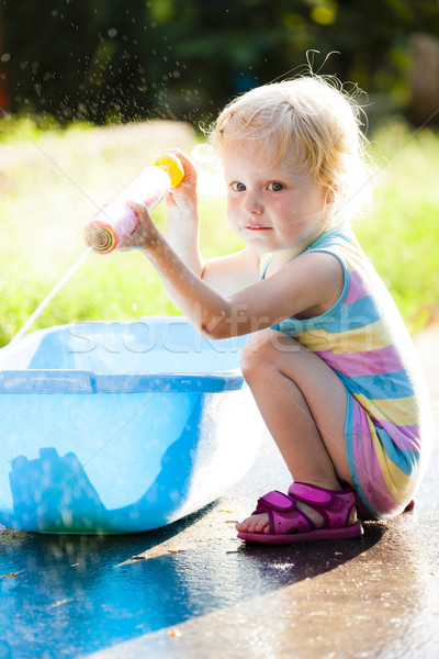 toddler girl playing with water sprayer in summer Stock photo © phbcz