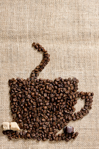 cup of coffee made of coffee beans with sugar and chocolate Stock photo © phbcz