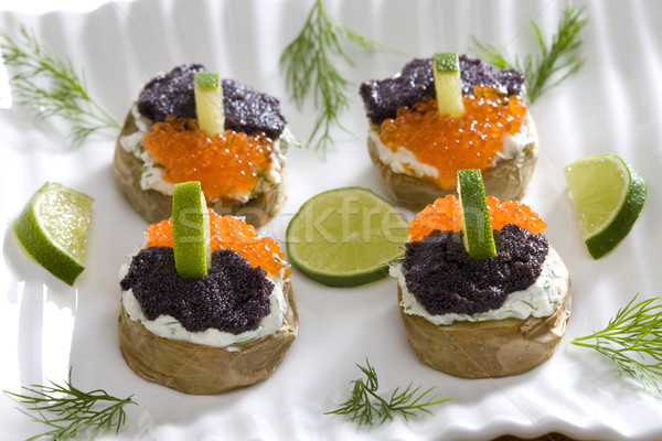 roasted potatoes wth caviar Stock photo © phbcz