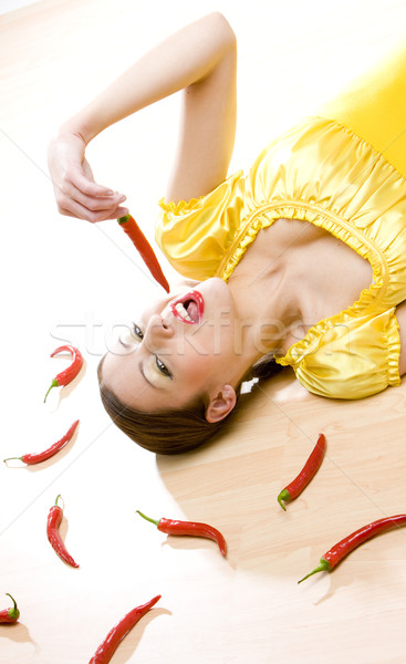 portrait of woman with chilis Stock photo © phbcz