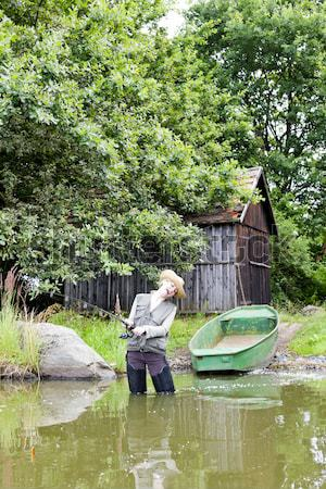 woman fishing in pond in spring Stock photo © phbcz