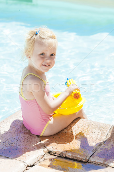 little girl with water sprayer by swimming pool Stock photo © phbcz