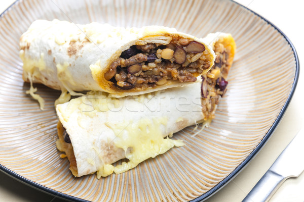 burrito filled with beef minced meat and beans baked with gouda  Stock photo © phbcz
