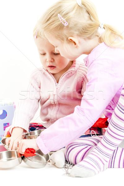 Kettő kislányok játszik gyermek edény lány Stock fotó © phbcz