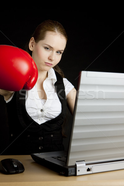 businesswoman with a notebook and boxing glove Stock photo © phbcz