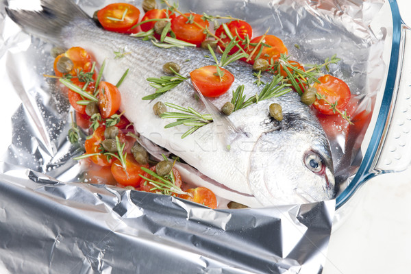 raw bream with herbs and cherry tomatoes Stock photo © phbcz