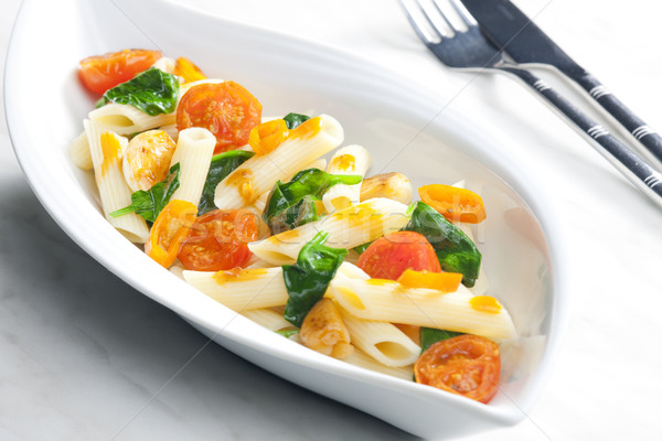 pasta penne with spinach and cherry tomatoes Stock photo © phbcz