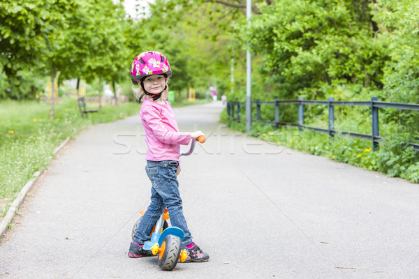 Stock photo: little girl with a scooter