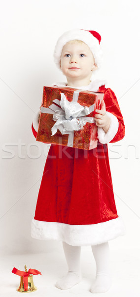 little girl as Santa Claus with a bell and Christmas present Stock photo © phbcz