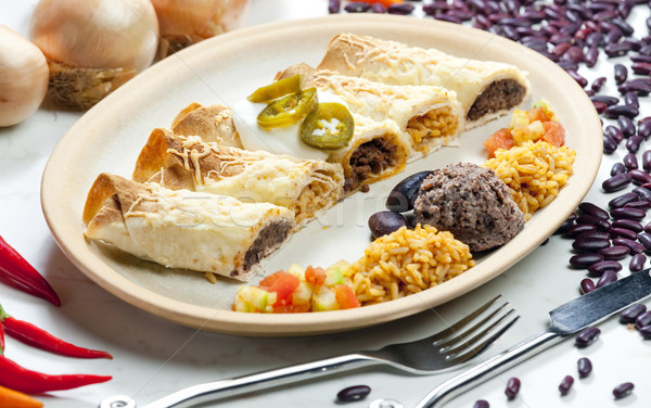 burritos with beans and rice Stock photo © phbcz