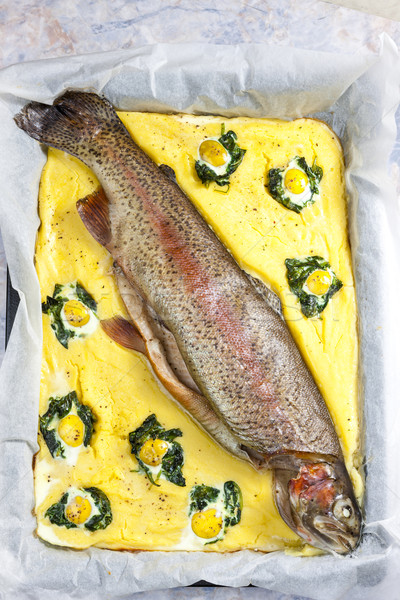 trout salmon baked with spinach ane quail eggs Stock photo © phbcz