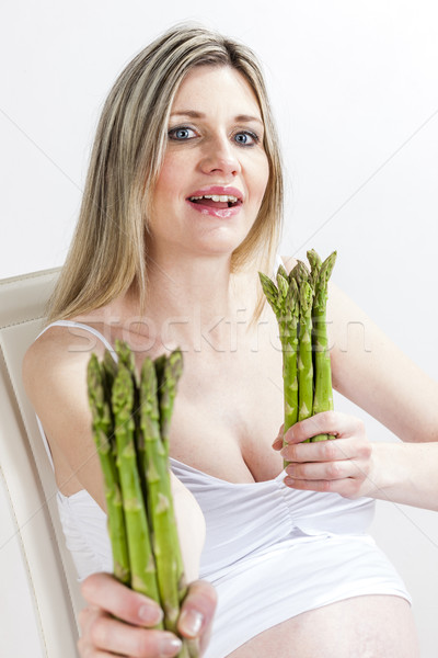 portrait of pregnant woman holding green asparagus Stock photo © phbcz