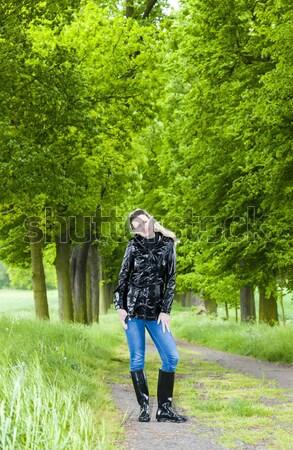 Mujer botas de goma caminando primavera callejón Foto stock © phbcz