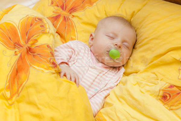sleeping baby girl in big bed Stock photo © phbcz
