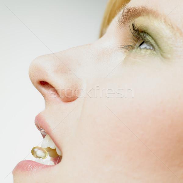 Kadın vitamin sağlık tıp ağız genç Stok fotoğraf © phbcz