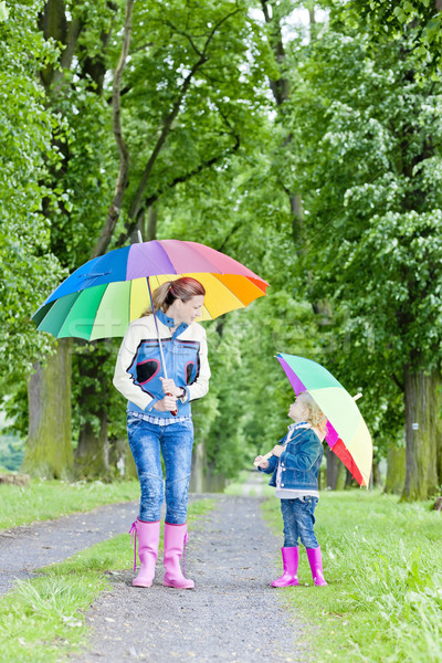 Madre hija paraguas primavera callejón mujer Foto stock © phbcz