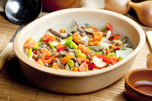Stock photo: beef meat with peppers, onion and capers