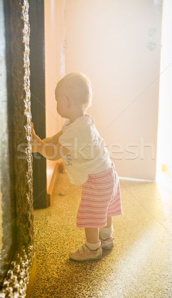 standing toddler in a room Stock photo © phbcz