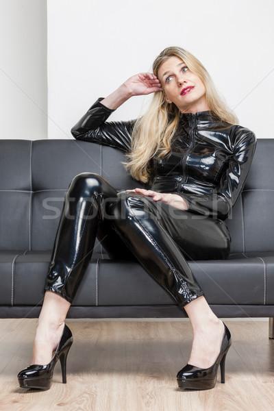 Nő visel fekete extravagáns ruházat ül Stock fotó © phbcz