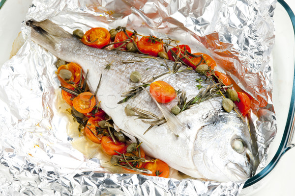 bream baked with herbs and cherry tomatoes Stock photo © phbcz