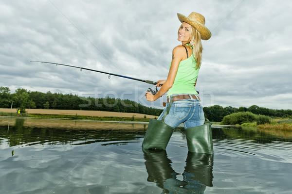 Kobieta połowów staw sportu kobiet stałego Zdjęcia stock © phbcz