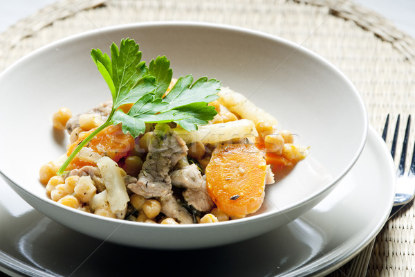 pork meat on celery with carrot and chick peas Stock photo © phbcz