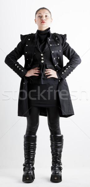 áll nő visel extravagáns ruházat csizma Stock fotó © phbcz
