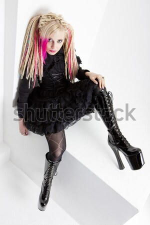 sitting woman wearing latex clothes Stock photo © phbcz