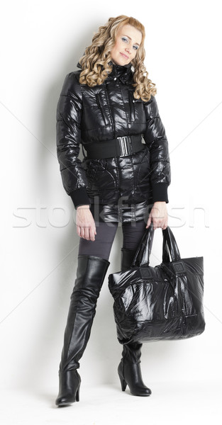 standing woman wearing black clothes holding a handbag Stock photo © phbcz