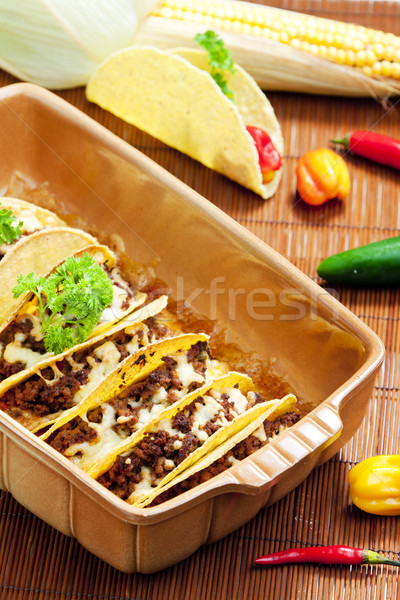 baked tacos with minced meat and cheese Stock photo © phbcz