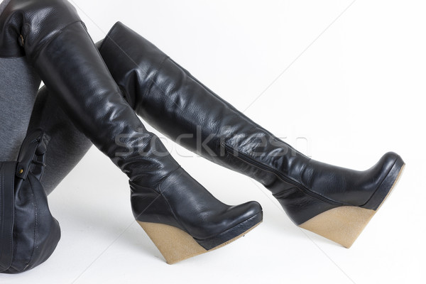 detail of sitting woman wearing platform black boots Stock photo © phbcz