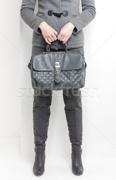 detail of standing woman wearing grey boots with a handbag Stock photo © phbcz