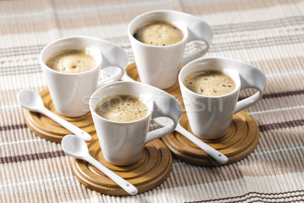 cups of coffee on place mats Stock photo © phbcz
