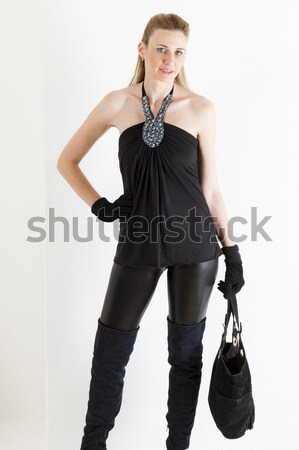 sitting woman wearing black clothes and boots with a handbag Stock photo © phbcz