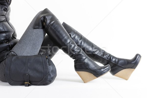 detail of sitting woman wearing platform black boots with a hand Stock photo © phbcz